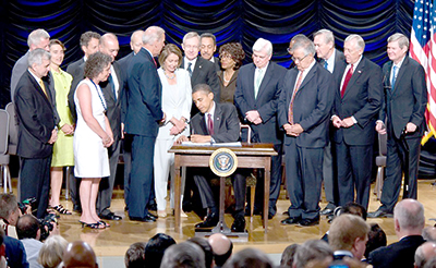 US President Barack Obama signs Dodd-Frank into law on 21 July 2010
